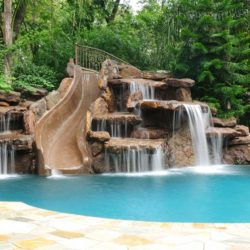 Amazing swimming pool with big slide and waterfalls.