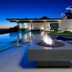 Beautiful geometric inground pool with fire pit.