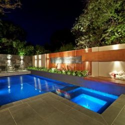 Beautiful geometric pool at night.