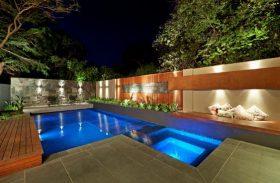 Beautiful geometric pool at night.