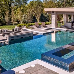 Geometric swimming pool with beautiful hardscape.