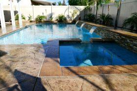 Geometric swimming pool with hot tub.
