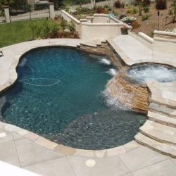 Small inground pool with swim spa.