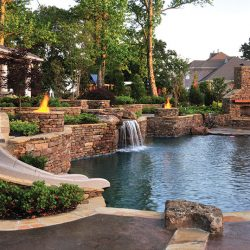 Pool with beautiful hardscape and slide.