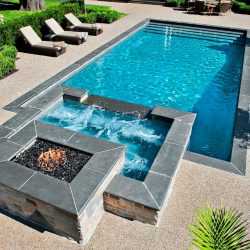 Pool with fireplace hardscape.