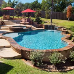 Elevated swimming pool with great hardscape.