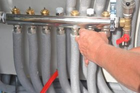hands on gray pipes