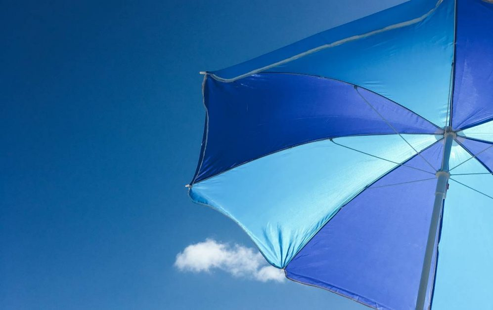 Photo of a blue umbrella by Max Hofstetter on Unsplash