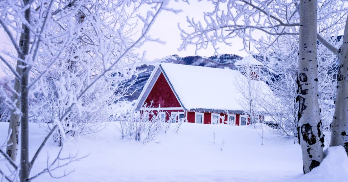 Image of a cozy home in snow.