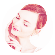 Portrait of young woman smiling with closed eyes touching face over white background.