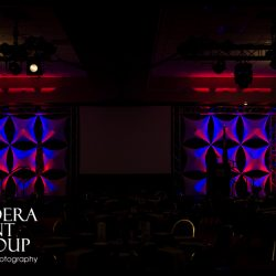 Stage lighting using blue and red lights for an event