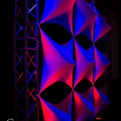 Blue and red stage lighting effects for an event