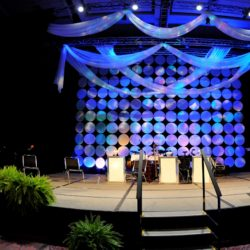 Stage decorations with blue, purple, and white event lighting