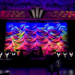 Stage lighting with blue, red, and yellow lights with custom stage design