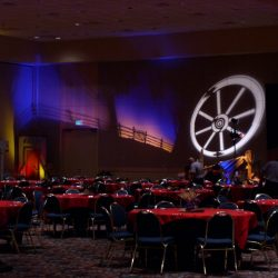 Western themed event lighting and event decorations with red table cloths