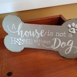 Some dog themed home decor at our doggy daycare - Canine Oasis