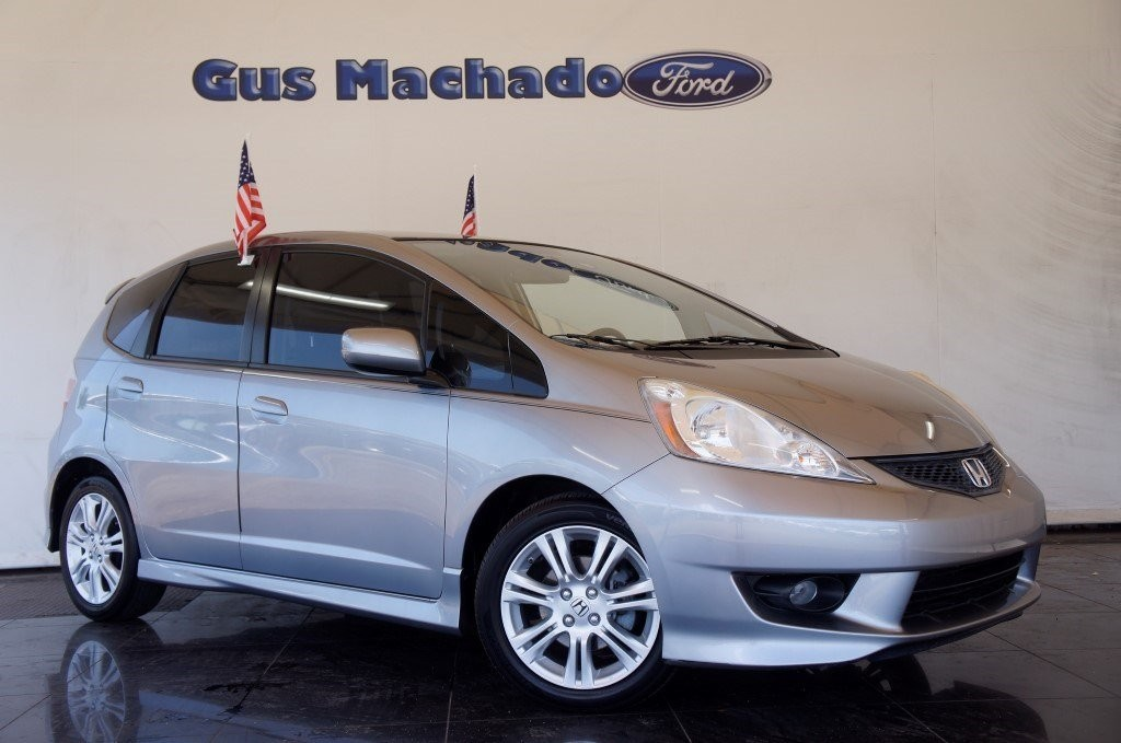 Silver honda with american flags at Gus Machado Ford by CarData