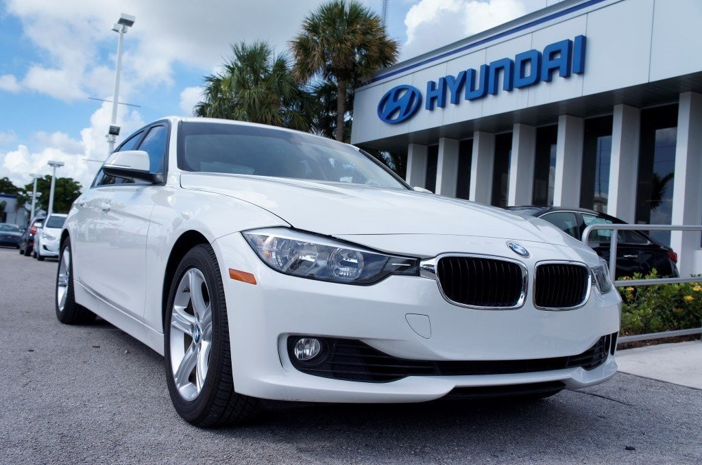 BMW in White at a Hyundai Dealership by CarData