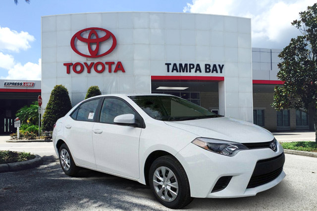 White Toyota in the shad in front of Tampa Bay Toyota By CarData