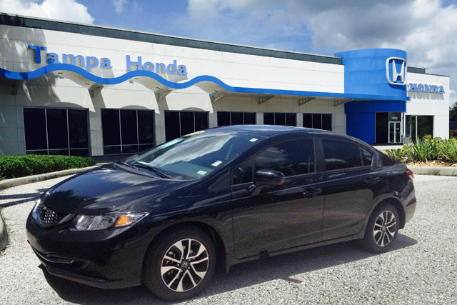Black car outside of Tampa Honda by CarData