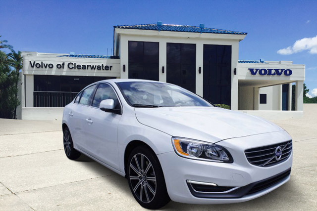 White Volvo in front of Volvo of Clearwater by CarData