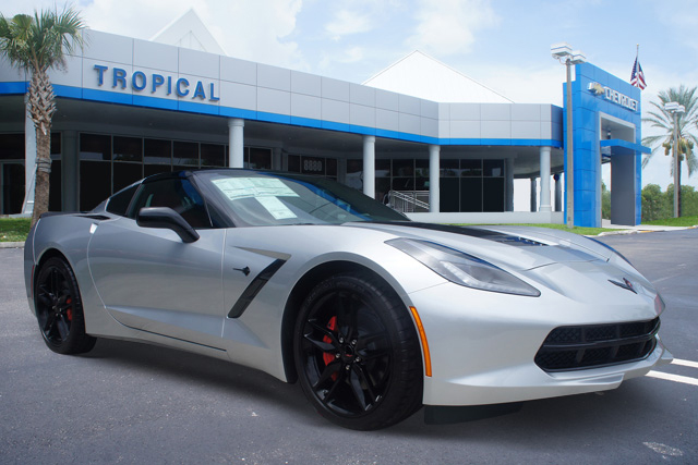 Silver and Black Corvette in front of Tropical Chevrolet Dealer by CarData