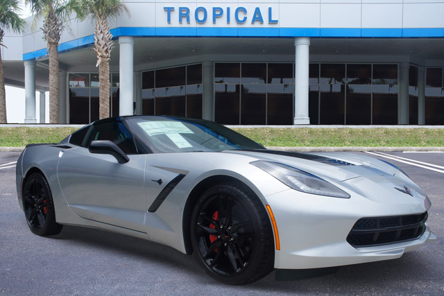 Silver Corvette in front of Tropical Chevrolet Dealer by CarData