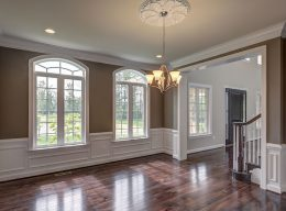 The entryway and front room of a luxury home designed by CarrHomes in Hamilton.