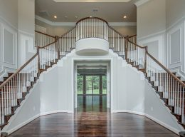 A grand, dual staircase in the entryway of a new home from CarrHomes in Hamilton.