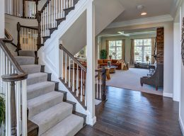 The staircase and view of the entryway showing off the interior home design from CarrHomes in Hamilton.
