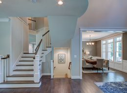 The staircase and dining room from CarrHomes luxury home builders in Hamilton.