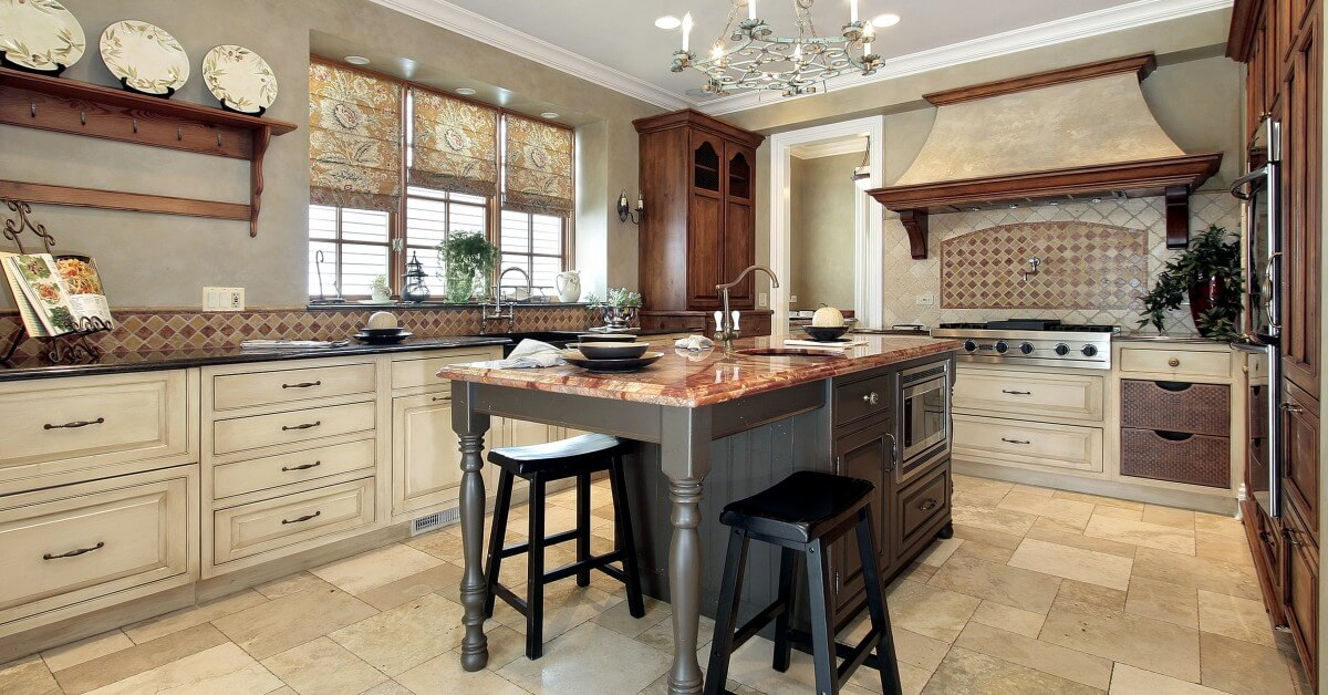 The interior house design of a kitchen with distressed white cabinets and an island from CarrHomes in Hamilton.