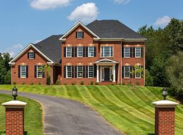 The exterior of a red brick designer home from CarrHomes in Hamilton.