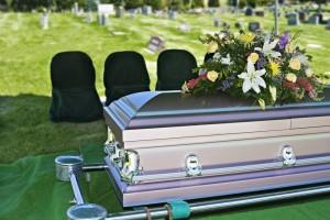 Stock photo graveside casket flowers