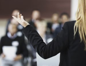 Closeup of a lecturer speaking to a group of business people