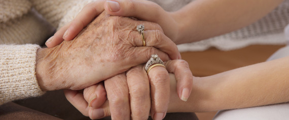 woman holding hands with senior woman