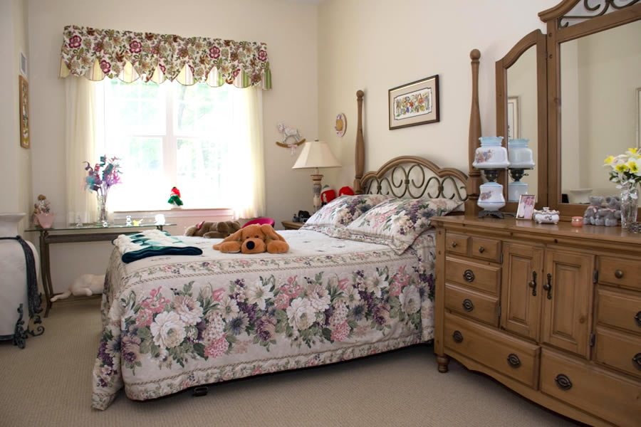Beautiful bedroom at senior living center in Windsor