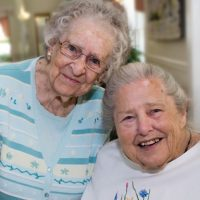 Beautiful residents of Windsor retirement community smile together