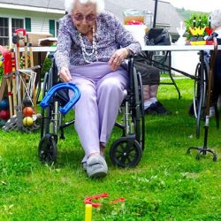 Happy woman tosses horseshoe at Windsor nursing home