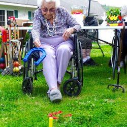 Happy woman tosses horseshoe at Windsor nursing home