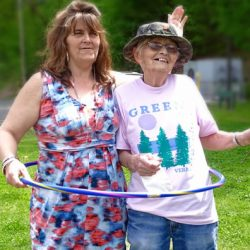 Staff and resident of Windsor nursing home hula hoop together