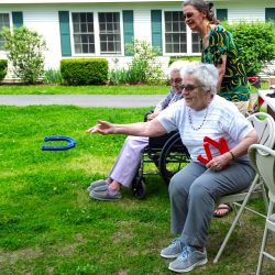 Residents of retirement community in Windsor play horseshoes