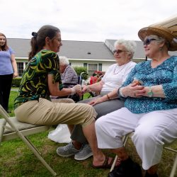 Residents wait in line for hand massages at assisted living home in Windsor