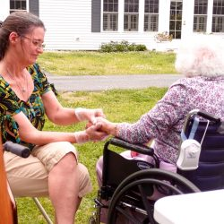 Hand massage at dementia care facility in Vermont