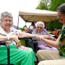 Residents receive hand massage at nursing home in Windsor