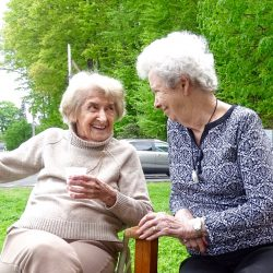 Two residents share smiles at retirement home in Windsor
