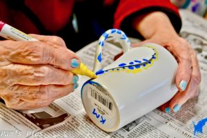 Life in Memory Care - hand painting a mug