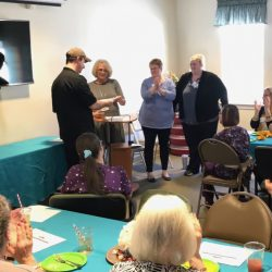 Staff clap in recognition of awards at assisted living home in Windsor