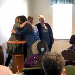 Employees share hugs at ceremony at retirement village in Windsor