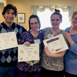 Employees hold up awards at dementia care center in Vermont
